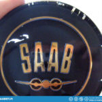 The Saab Sport horn button had some scratches in the paint which made the blue color un-even.