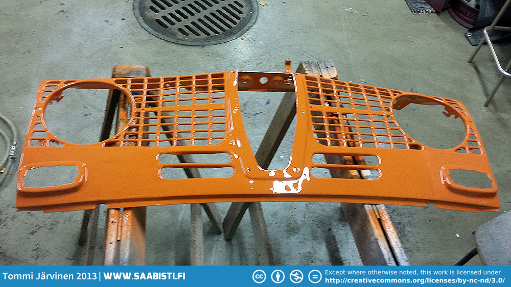 I beat the grille more or less straight and proceeded to painting it orange.