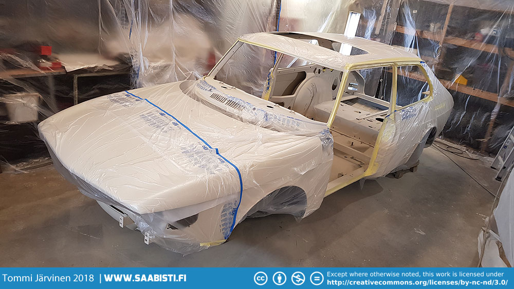 Car masked for painting the interior.